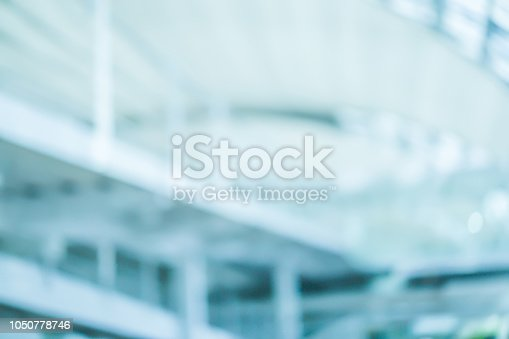 istock abstract blurred inside of new design modern construction airport at international terminal lounge departure for design background as banner, presentation , ads concept 1050778746