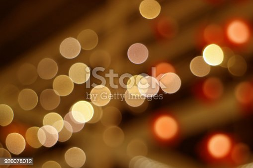 istock Abstract blurred interior decorated lighting in brown and orange color gradations 926078012