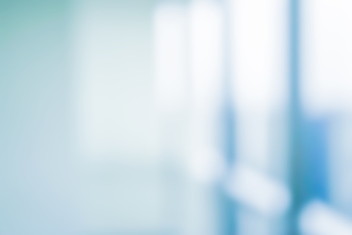 Abstract Blurred Interior Of Corridor Clinic Background In Blue Color Blurry Image For Presentation Banner Ads Design Concept Stock Photo - Download Image Now