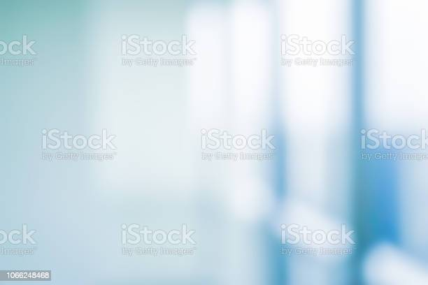 Photo of abstract blurred interior of corridor clinic background in blue color , blurry image for presentation ,banner ,ads design concept