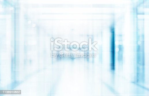 1138910853 istock photo Abstract blurred interior of corridor clinic background in blue color , blurry image 1138910852