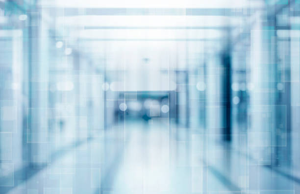 abstract blurred interior of corridor clinic background in blue color , blurry image - medical technology stock pictures, royalty-free photos & images