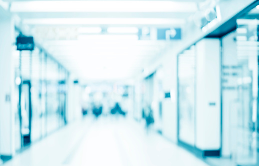 1138910853 istock photo Abstract blurred interior of corridor clinic background in blue color , blurry image 1144642788
