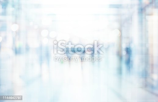 1138910853 istock photo Abstract blurred interior of corridor clinic background in blue color , blurry image 1144642797