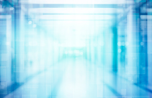 1138910853 istock photo Abstract blurred interior of corridor clinic background in blue color , blurry image 1202473639