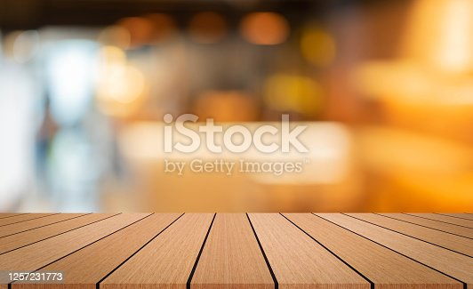 864907996 istock photo abstract blurred interior of restaurant bar background and modern wood counter table perspective background for show, promote, advertise product on display montage concept 1257231773