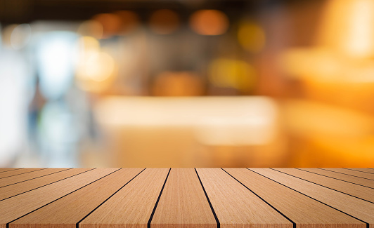 593305530 istock photo abstract blurred interior of restaurant bar background and modern wood counter table perspective background for show, promote, advertise product on display montage concept 1257231773