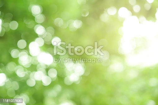 blurred garden outdoor view form window form living room in the morning background with white marble pattern tabletop for show, promote ads and design product on display concept