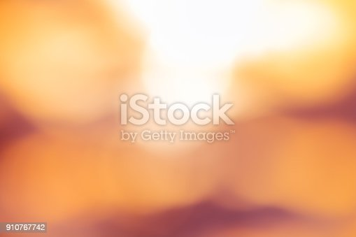 Orange and yellow light bokeh with sun light in blurred background