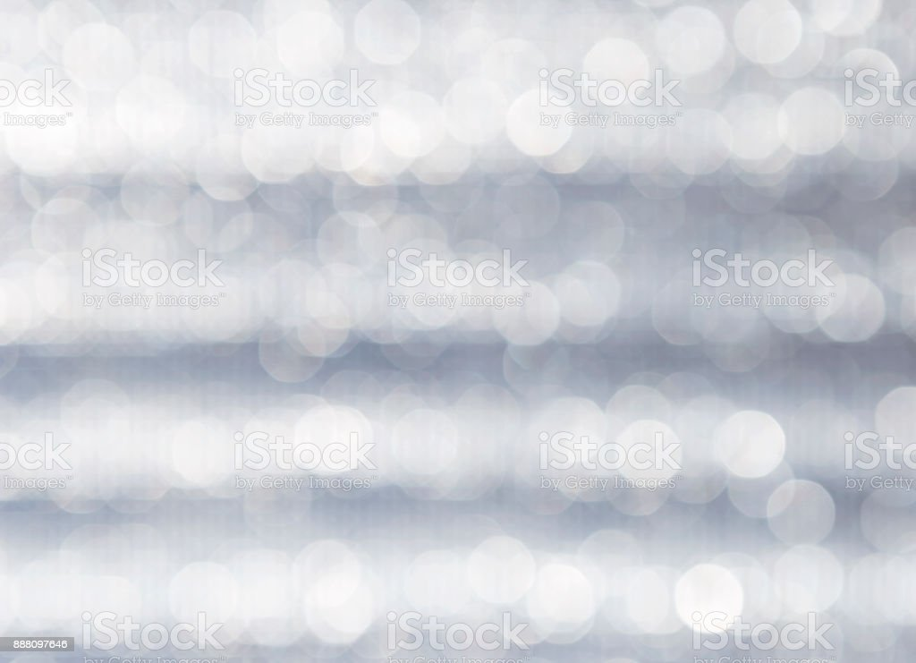 Abstract blurred light bokeh over grey background stock photo