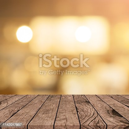 864907996istockphoto abstract blurred modern interior coffee cafe shop decorate with bulbs lamp light on ceiling and vintage wood counter table perspective for show, promote, advertise product on display montage concept 1142017857