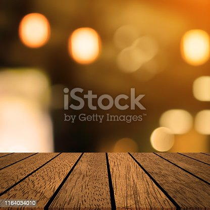 864907996istockphoto abstract blurred modern interior coffee cafe shop decorate with bulbs lamp light on ceiling and vintage wood counter table perspective for show, promote, advertise product on square display 1164034010