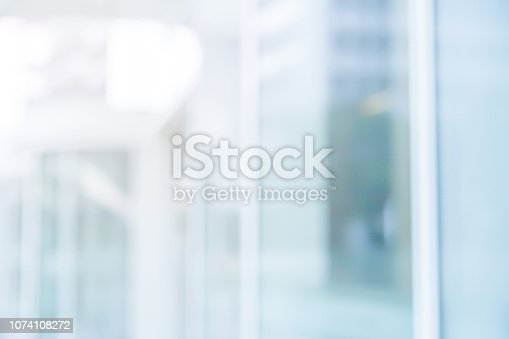 876037346istockphoto abstract blurred modern interior of office condominium background with night form glass reflection building for presentation , banner design 1074108272