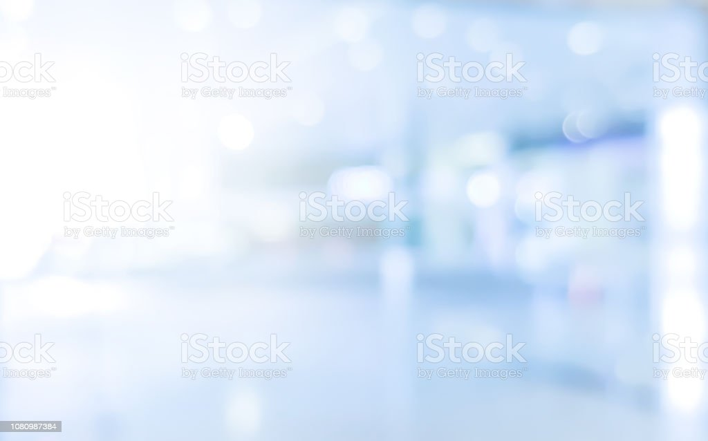 abstract blurred modern interior of office hospital background with light form glass reflection building for presentation , banner design abstract blurred modern interior of office hospital background with light form glass reflection building for presentation , banner design Abstract Stock Photo