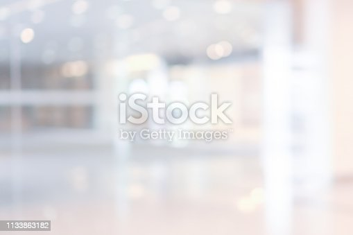 1068830604 istock photo abstract blurred modern interior of office hospital background with light form glass reflection building for presentation , banner design 1133863182