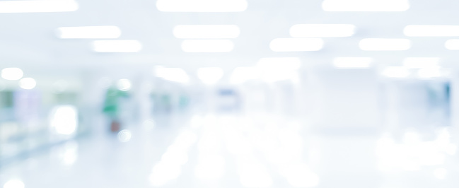 1068830604 istock photo abstract blurred modern interior of office hospital in panoramic background with light form lamp ceiling building for banner design 1143010791
