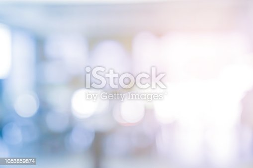 abstract blurred modern interior workplace background with orange color light for design as ads, banner, presentation