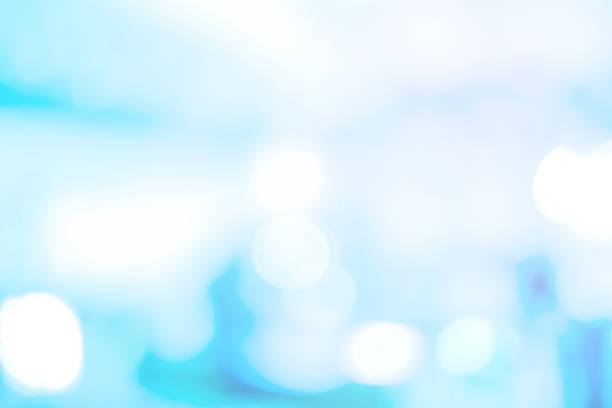 abstrakte verschwommene modernen interieur arbeitsplatz der medizinische hintergrund mit glänzenden licht für design wie anzeigen, banner, präsentation - op leuchte stock-fotos und bilder