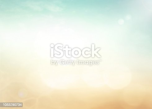 Bokeh light with blur autumn sunset beach background