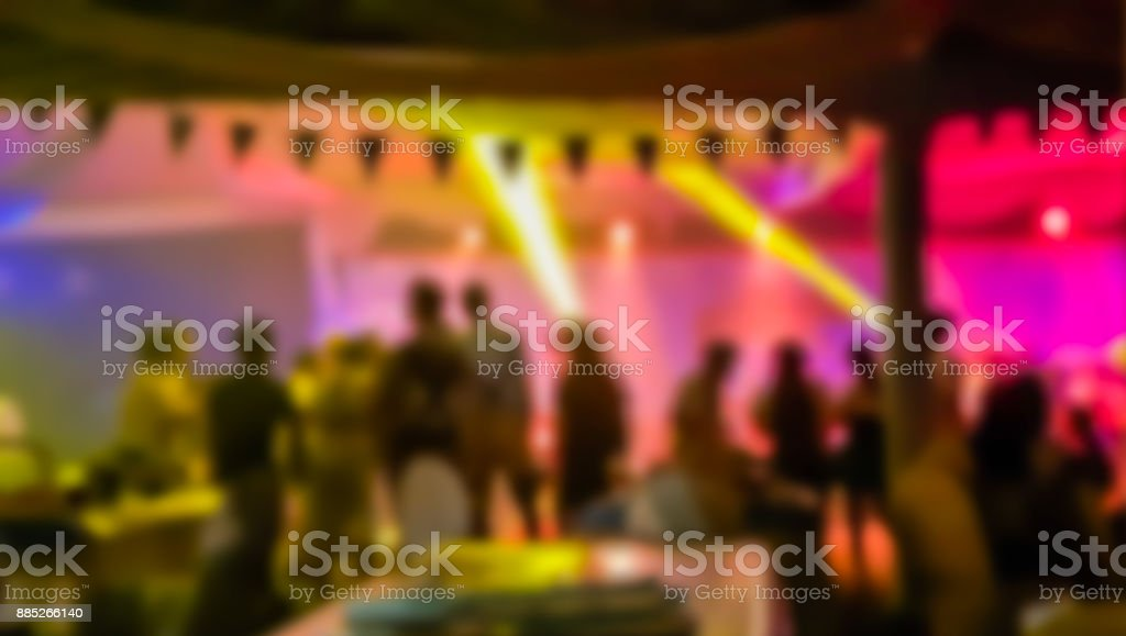Abstract blurred night party with light concert in Blur background...