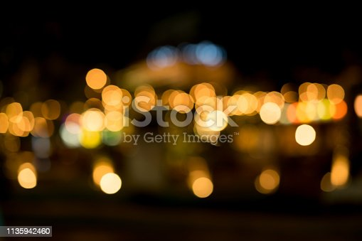 877010878 istock photo abstract blurred nightclub background in low light dark color 1135942460