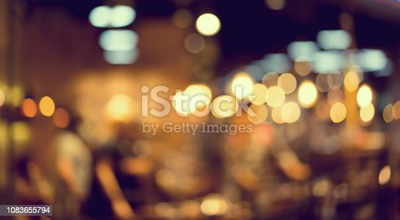 abstract blurred nightclub party event in dark color tone background with spotlight bokeh interior for design ad and banner template concept