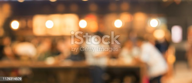 istock abstract blurred nightclub party event in dark color tone background with spotlight bokeh interior for design ad and banner template concept 1129314529