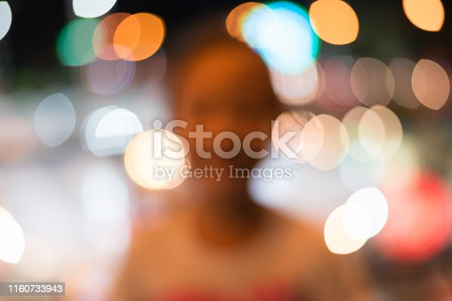 Abstract blurred of asian kid girl with bokey festival light for background