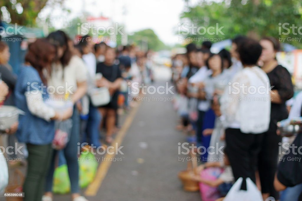 Abstract blurred of people line up at temple stock photo