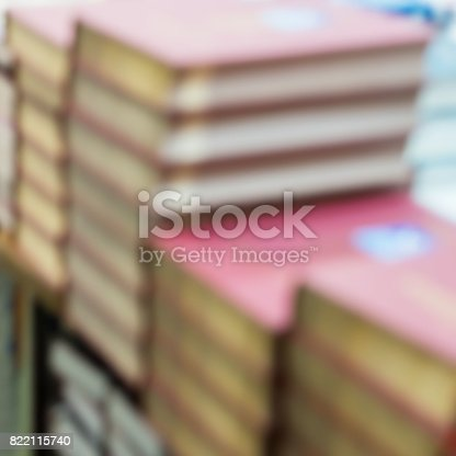 istock Abstract blurred of stops of books, textbooks or fiction in book store or in library. Education, school, study, reading fiction concept. Abstract background 822115740