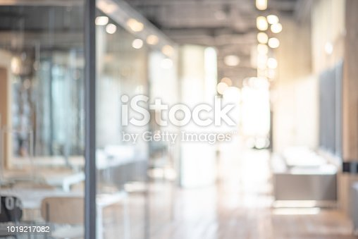 istock Abstract blurred office interior room. blurry working space with defocused effect. use for background or backdrop in business concept 1019217082