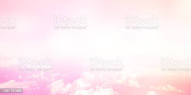 Photo of abstract blurred pastel pink color tone as panoramic background and clouds with glowing shine light filter for design concept