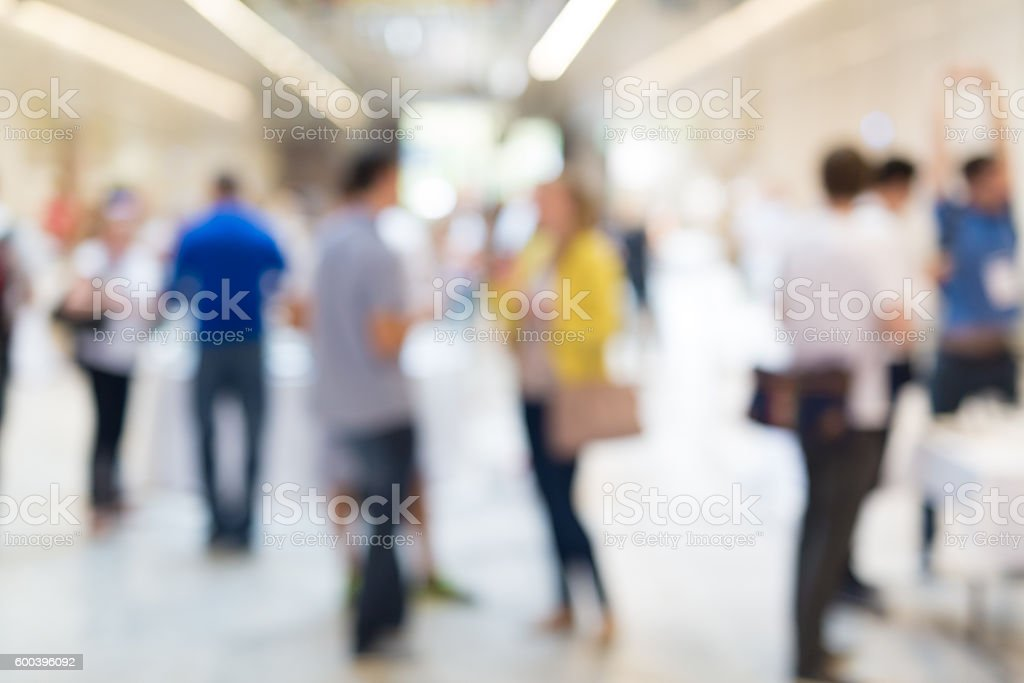 Abstract blurred people socializing during coffee break at business conference. stock photo