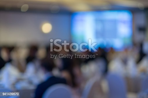 istock Abstract blurred photo of conference hall or seminar room 941439570