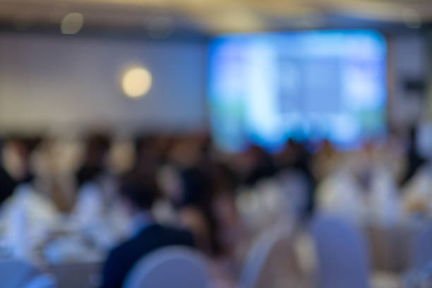 abstract blurred photo of conference hall or seminar room - awards ceremony stock photos and pictures