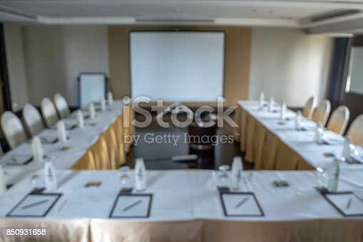 istock Abstract blurred photo of conference hall or seminar room without attendee background 850931658