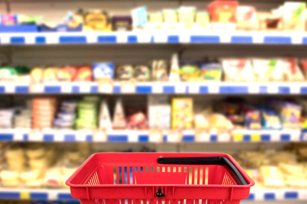 Abstract blurred photo of store with basket in department store bokeh background. business concept. Abstract blurred photo of store with basket in department store bokeh background. business concept convenience stock pictures, royalty-free photos & images