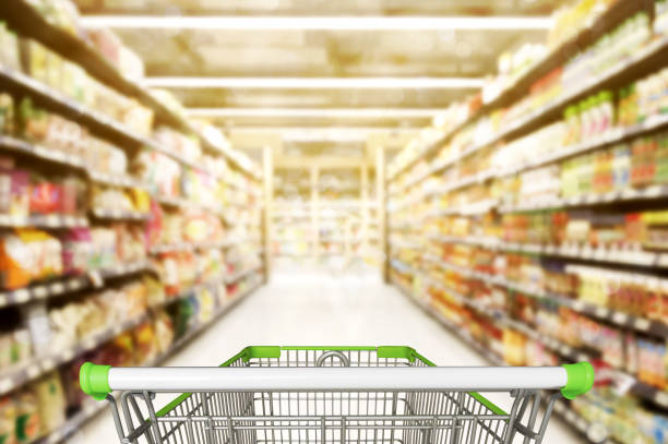 abstract blurred photo of store with trolley in department store bokeh background - consumer products stock pictures, royalty-free photos & images