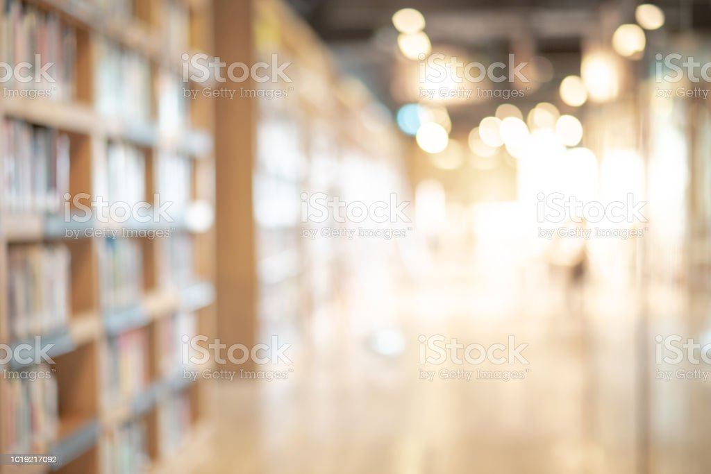 Abstract blurred public library interior space. blurry room with bookshelves by defocused effect. use for background or backdrop in business or education concepts stock photo