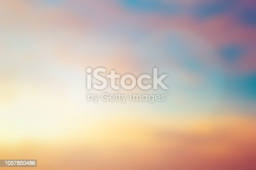 istock abstract blurred purple violet and orange gradient color beautiful natural background lens ray flare flash sunlight light. 1057850486