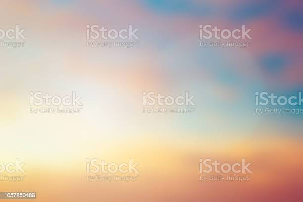 Photo of abstract blurred purple violet and orange gradient color beautiful natural background lens ray flare flash sunlight light.
