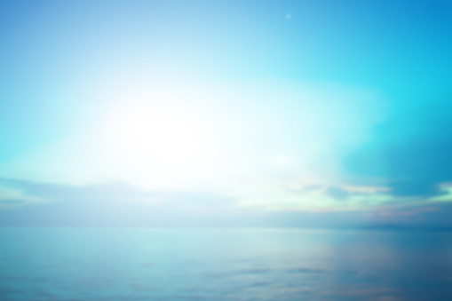 1010238190 istock photo abstract blurred sea water surface background in sunrise hour with pastel blue and teal tone color and flare light for design as presentation , banner , ads concept 1047124866