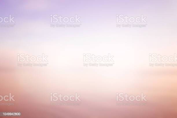Photo of abstract blurred sea water surface background in sunrise hour with pastel tone purple and orange color and flare light for design as presentation , banner , ads concept