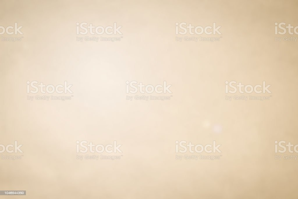 abstract blurred simple beige and tan color background with white light effect for design as presentation, ads ,  banner concept stock photo