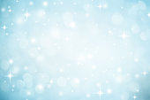 Abstract blurred soft blue and white beautiful glowing blinking bokeh and snowfall and star on colorful background for merry christmas and happy new year design banner  and presentation concept