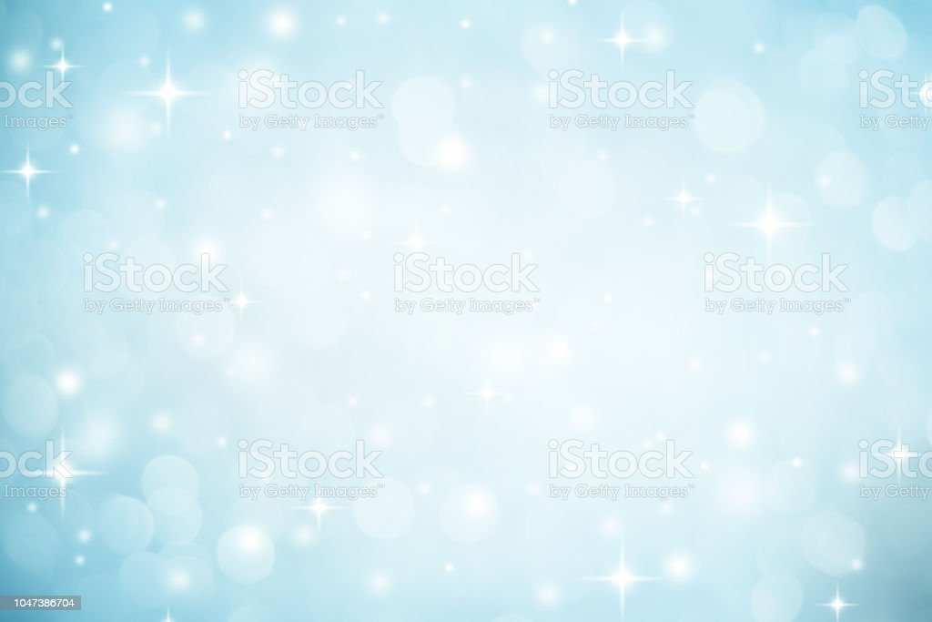 Abstracte wazig zachte blauwe en witte mooie gloeiende knipperende bokeh en sneeuwval en ster op kleurrijke achtergrond voor prettige kerstdagen en gelukkig Nieuwjaar ontwerpconcept banner en presentatie foto