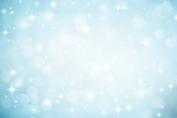 Abstract blurred soft blue and white beautiful glowing blinking bokeh and snowfall and star on colorful background for merry christmas and happy new year design banner  and presentation concept stock photo