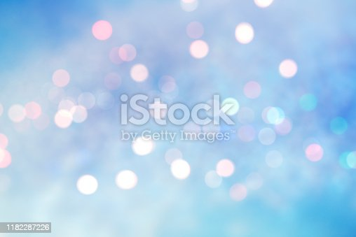 Abstract blurred soft blue and white beautiful glowing blinking bokeh and snowfall on colorful background for merry christmas and happy new year design banner and presentation concept