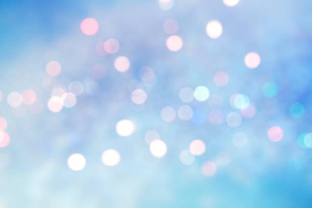 Abstract blurred soft blue beautiful glowing blinking bokeh stock photo