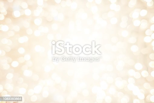 abstract blurred soft bright cream color background with glowing light and bokeh light effect for merry christmas and happy new year 2019 festival design and element  concept